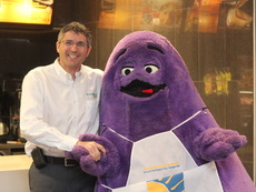 Chris thanking Grimace from McDonalds for breakfast